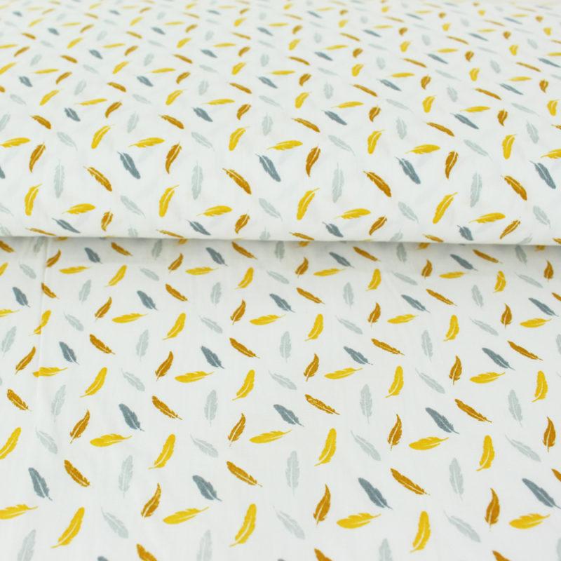 Tissu popeline de coton plumes pastels jaunes