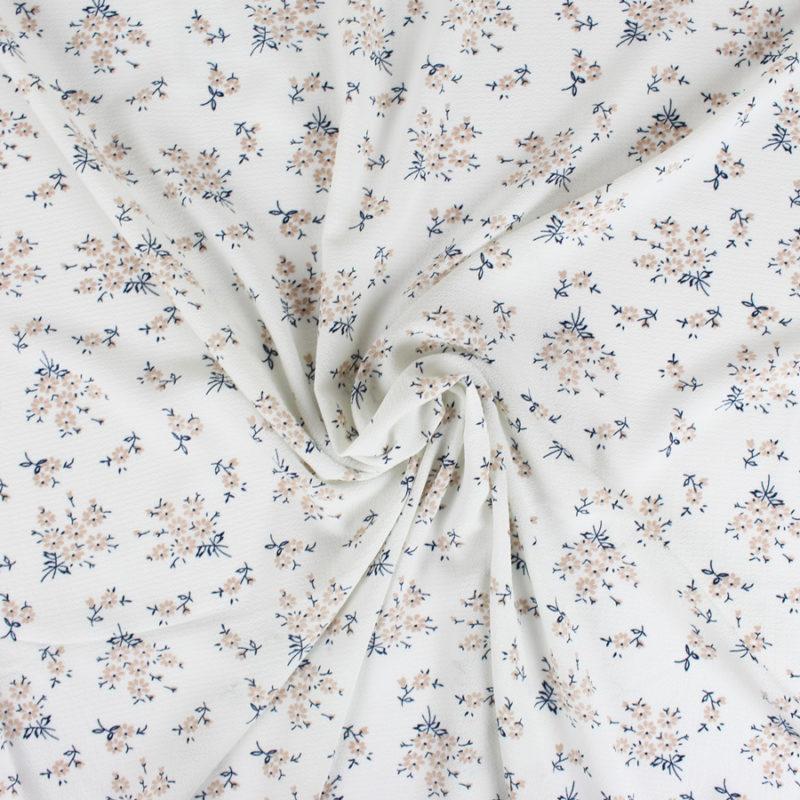 Tissu crêpe gaufré blanc à petites fleurs
