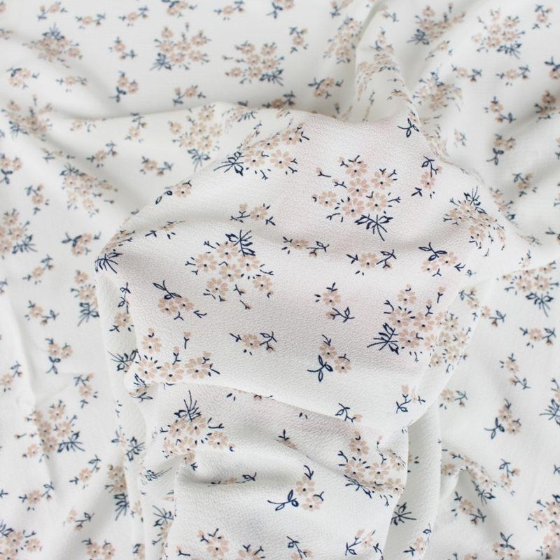 Tissu crêpe gaufré à petites fleurs blanc
