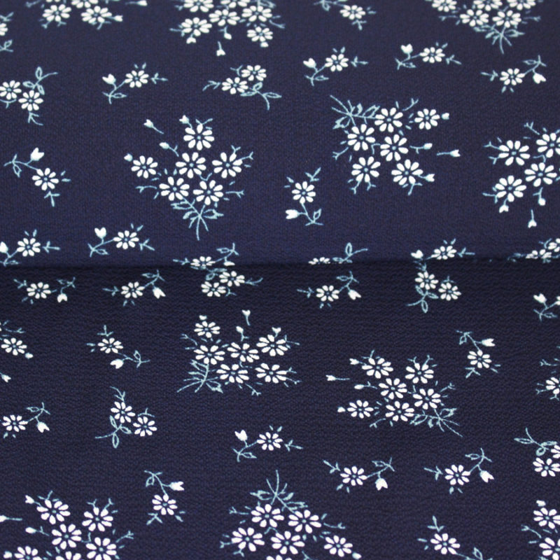 Tissu crêpe gaufré bleu marine à petites fleurs