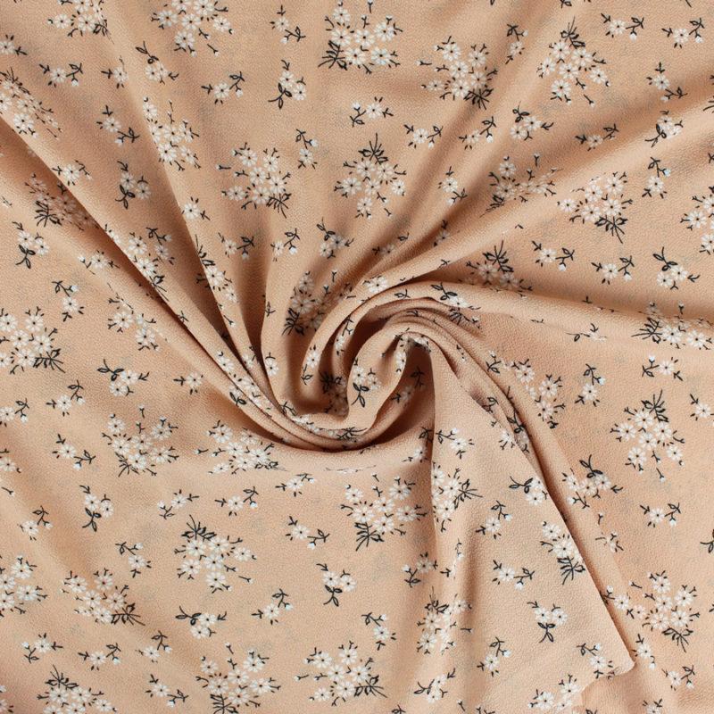 Tissu crêpe gaufré à petites fleurs saumon