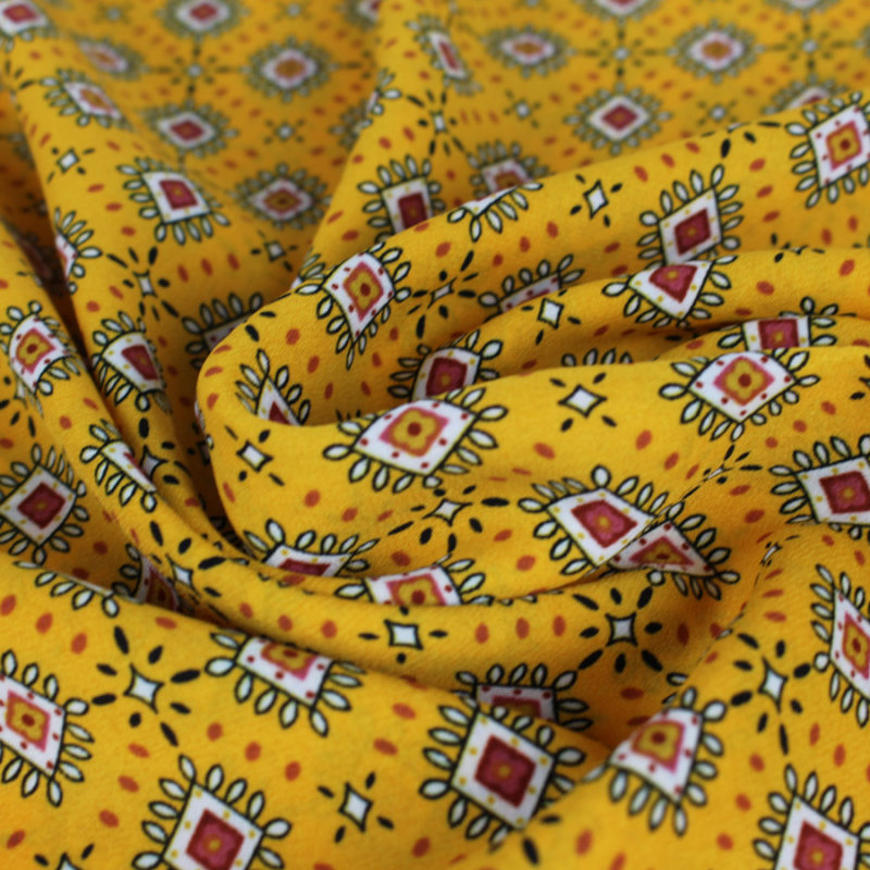 Tissu crêpe georgette à motifs losanges couleur safran